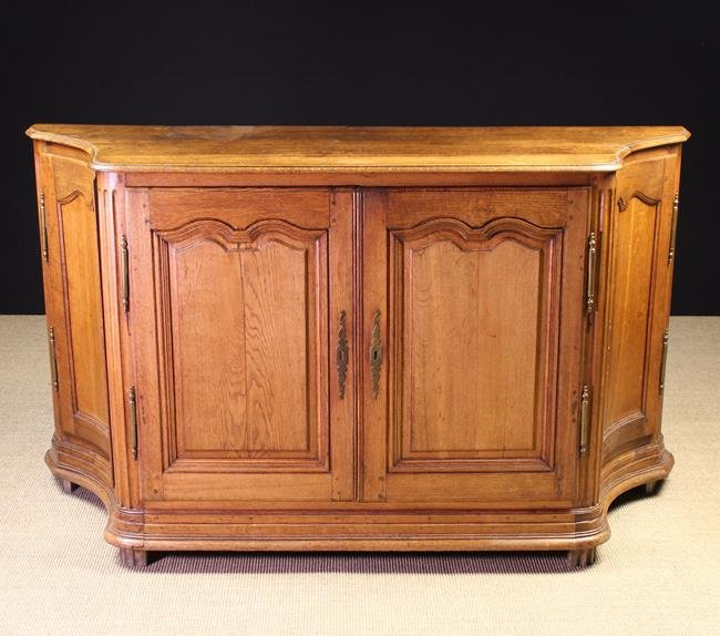 A 19th Century French Oak Side Cabinet. The shaped