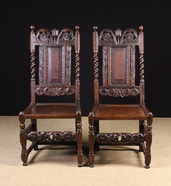 A Pair of Charles II Carved Oak Side Chairs. The