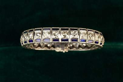 An 18 Carat Gold, Diamond & Synthetic Sapphire
