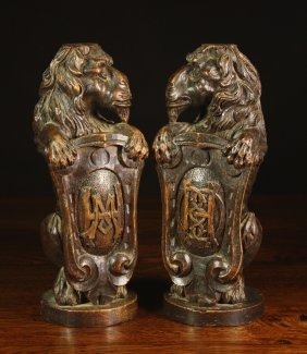 A Pair Of 19th Century Carved Oak Lions Sejant Hold