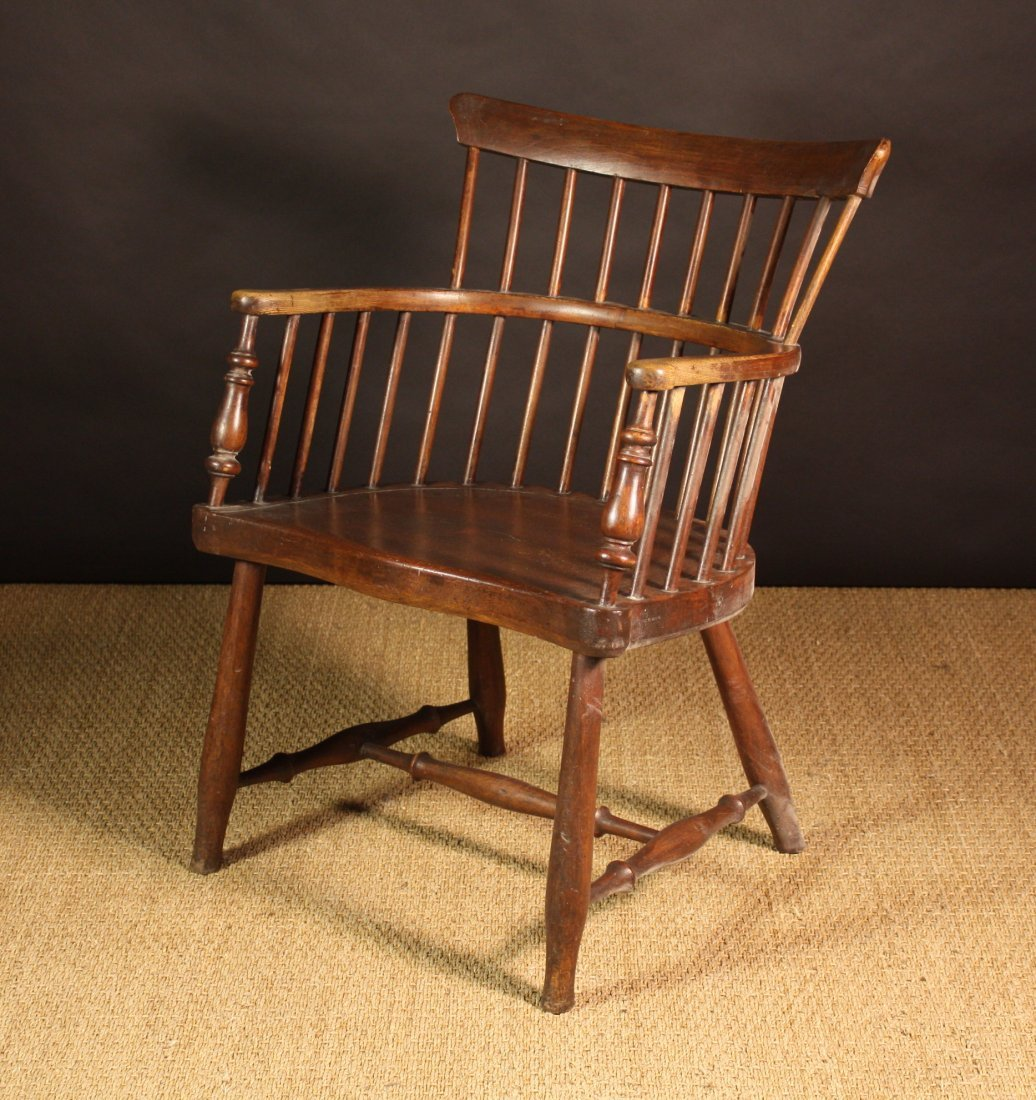 107: A 19th Century Low Comb Back Windsor Armchair of b