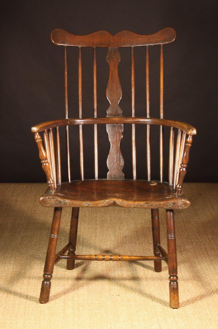 109: A Fine 19th Century Ash Comb Back Armchair. The sp