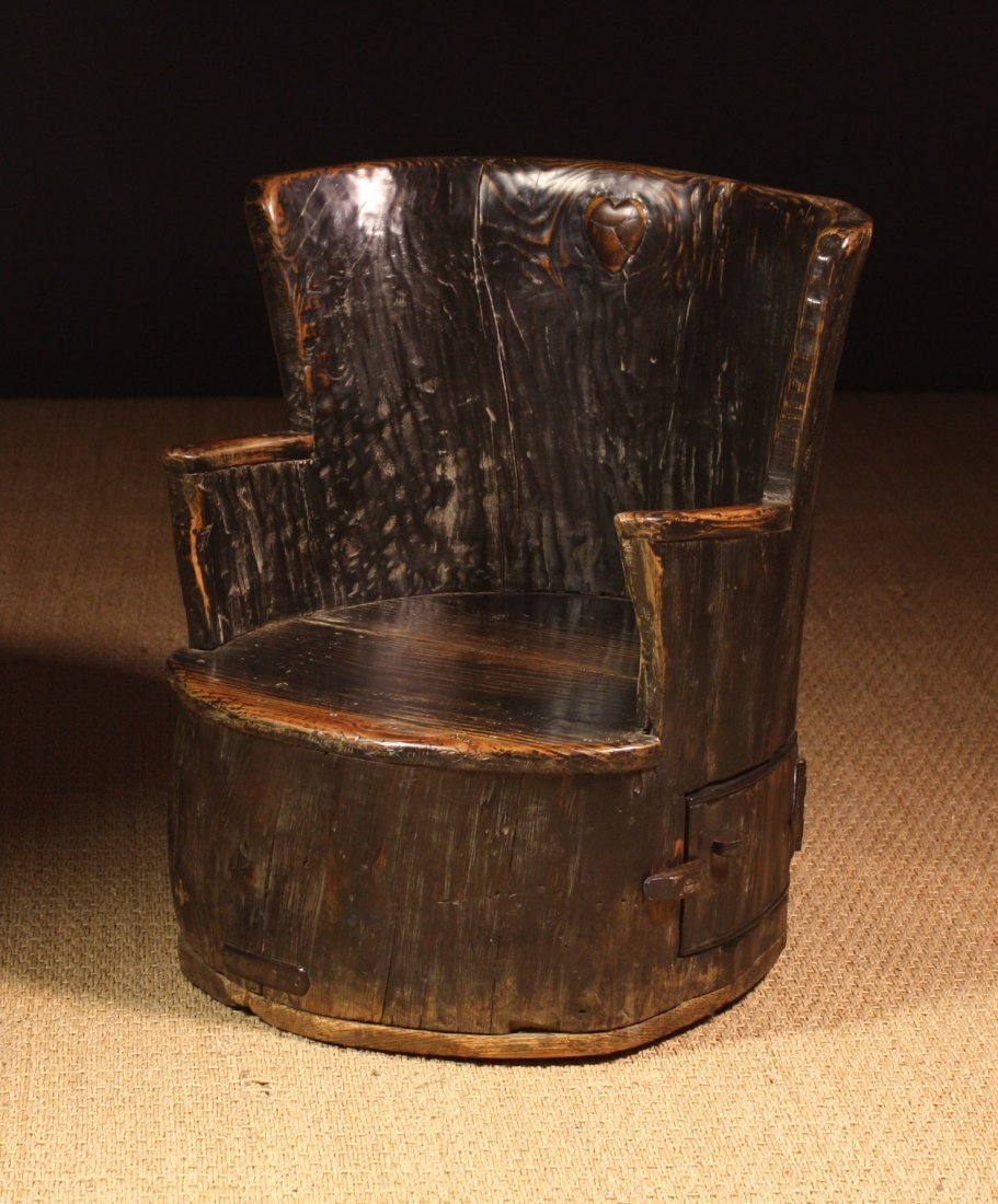 111: A Primitive Dug Out Childs Chair carved with a hea