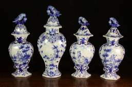 148: A Group of Four Blue & White Delft Jars & Covers: