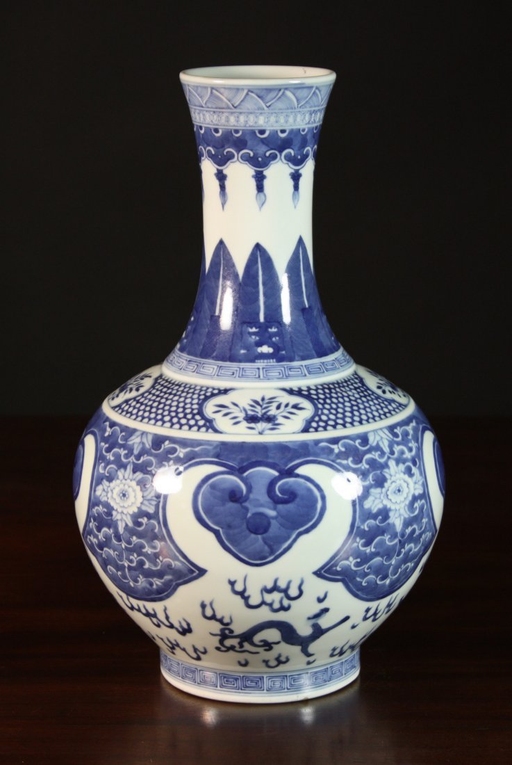 10: A Chinese Blue & White Baluster Vase decorated with