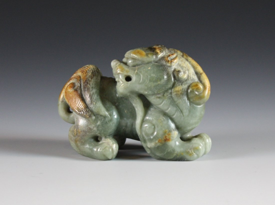 24: A Jade Carving of a Lion with head twisted behind.