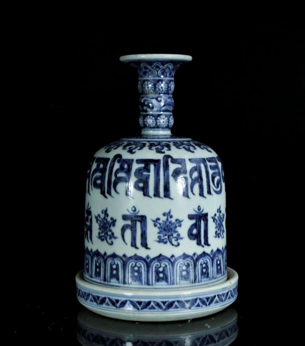 A blue and white box in shape of bell
