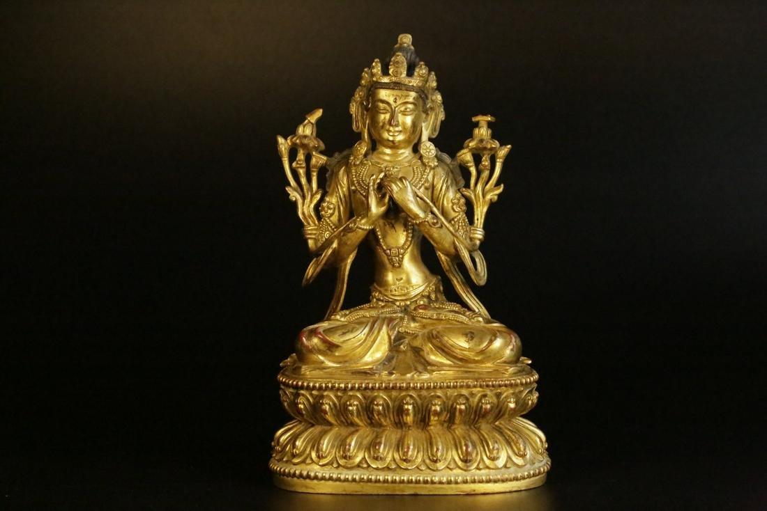 A gilt-bronze figure of manjusri