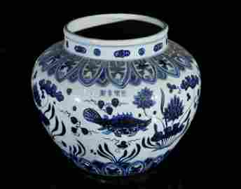 A blue and white 'fish' jar