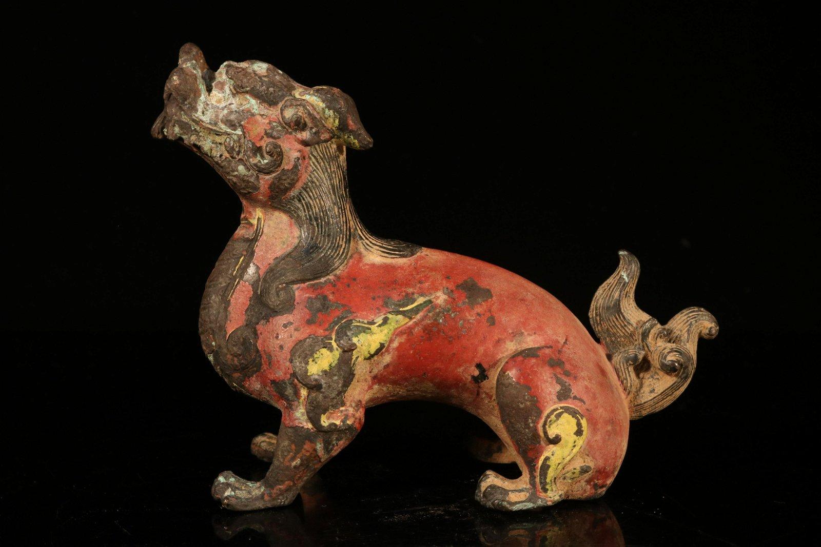 A bronze 'lion'ornament