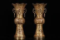 A pair of gilt-silver 'phoenix ' ornaments