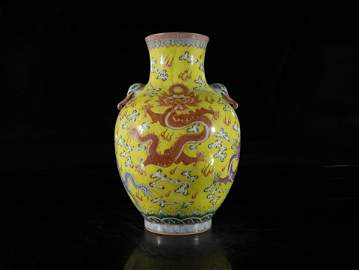 A yellow ground and famille-rose 'dragon' vase