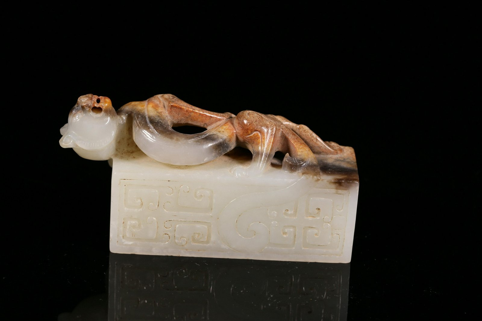 A Finely Carved White Jade 'Beast ' Decoration