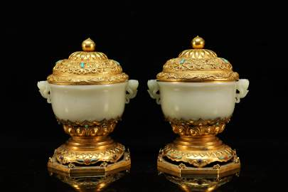 A Fine Pair of White Jade Lotus Cups