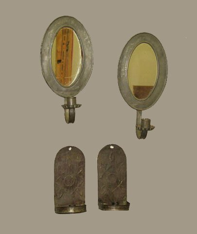 507: FOUR WALL CANDLE SCONCES. One pewter pair with ova
