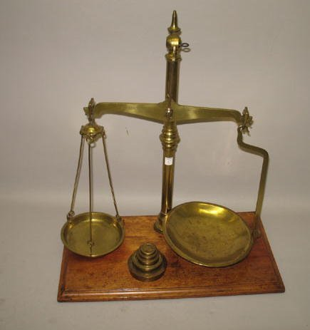 5: BRASS BALANCE SCALES. Set of scales on a wooden base