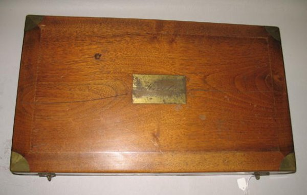 9: RARE SEAGOING SURGEON'S KIT. Walnut case with brass