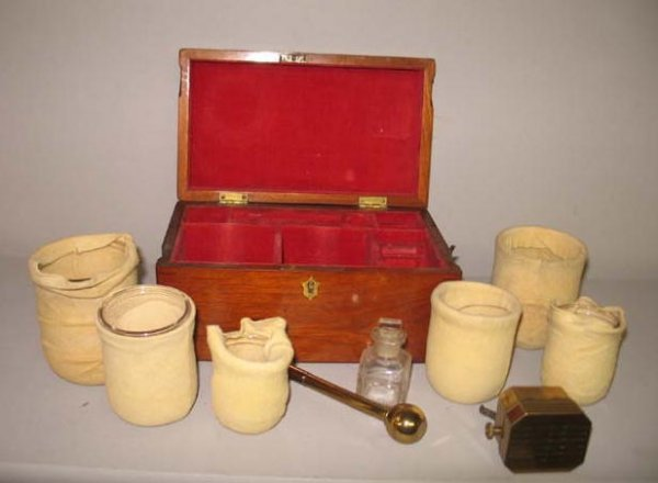 11: BLOODLETTING KIT. Mahogany case fitted with six blo