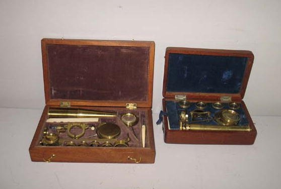 12: TWO CASED MONOCULAR MICROSCOPES. Both are brass wit