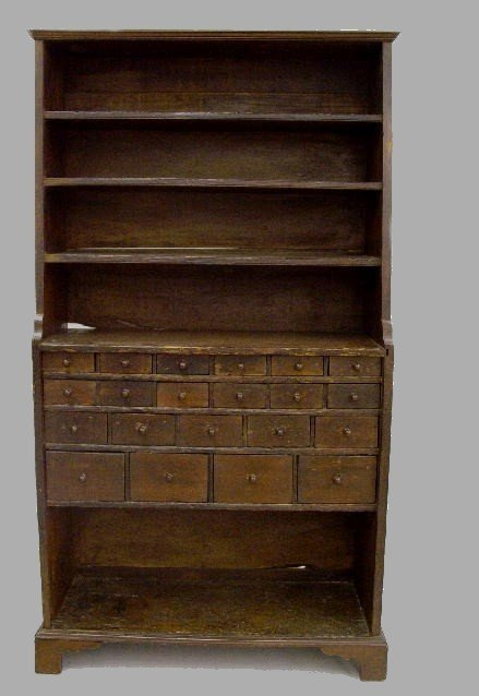 24: EARLY APOTHECARY CUPBOARD. Pine with old refinishin