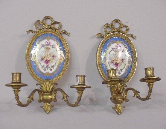 238: EIGHT PORCELAIN AND BRASS CANDLE SCONCES. Oval por