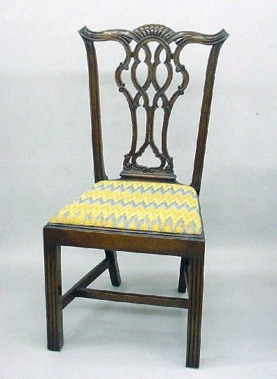 442: FOUR CHIPPENDALE STYLE SIDE CHAIRS. Mahogany with