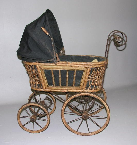 6: BENT WICKER DOLL BUGGY. Wicker sides and molding, tu