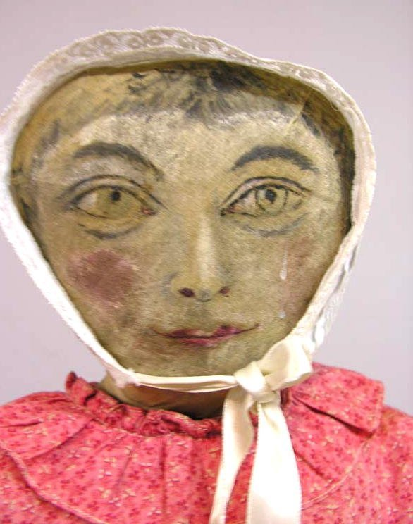 """211: OIL PAINTED CLOTH DOLL, 26"""". Head and torso made f"""