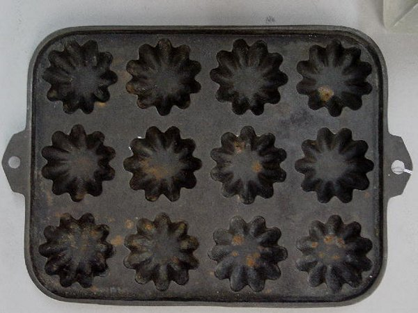 5: TWO CAST IRON CORN MUFFIN PANS. One has a