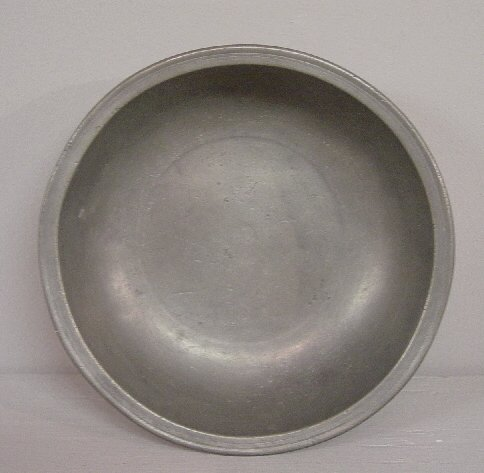 21: SMALL PEWTER BASIN. Partial eagle touch f