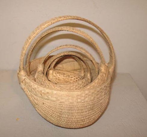 1295: SET OF FIVE GRADUATED BUTTOCKS BASKETS. Natural f