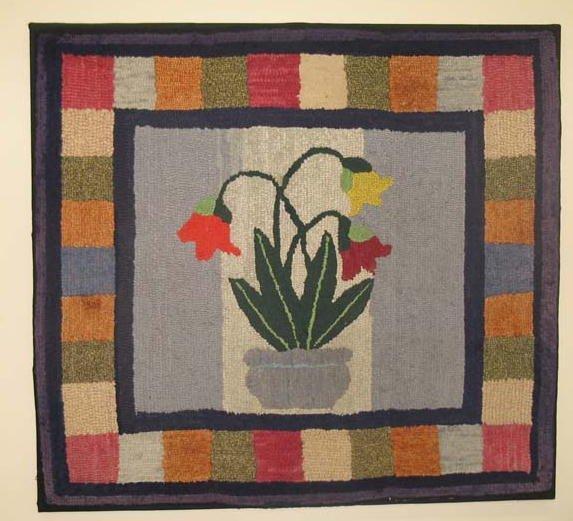 1429: HOOKED RUG. Wool on burlap. Colorful tulips in bo