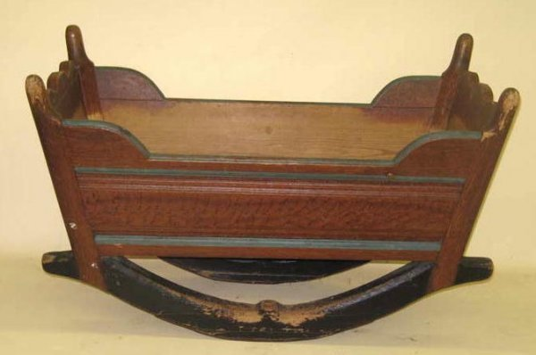 1431: DECORATED CRADLE. Pine. Post and panel constructi