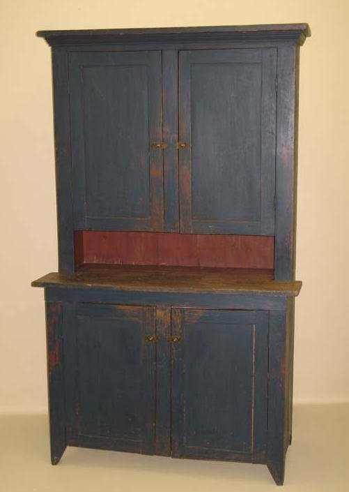 1438: PAINTED TWO-PIECE  WALL CUPBOARD. Attributed to P