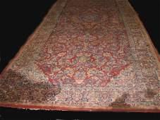 1516: ORIENTAL RUG. Room size Sarouk. Wide dark blue bo