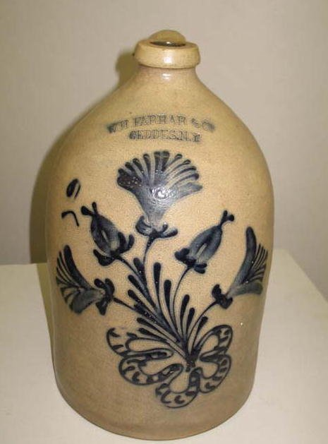 1837: STONEWARE JUG. Bold cobalt brushed flowers and a