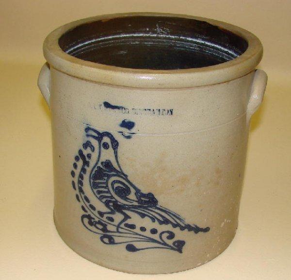 14: STONEWARE CROCK. Bright cobalt blue bird on a spott