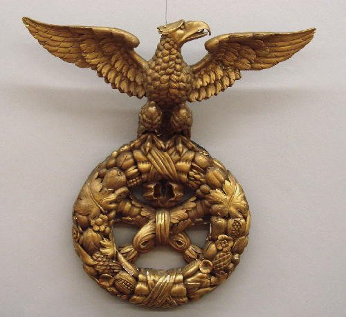 431: CARVED AND GILDED GESSO EAGLE ORNAMENT. The eagle,