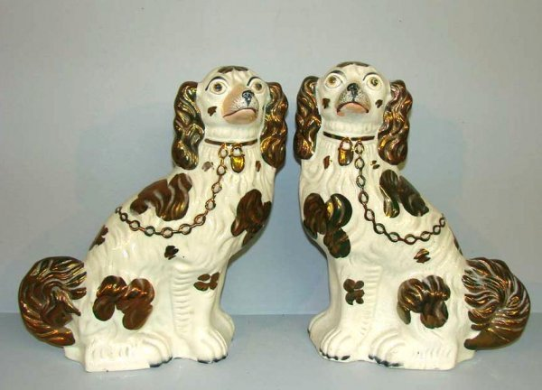 434: PAIR OF STAFFORDSHIRE SPANIELS. Copper lustre high