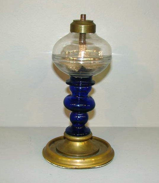 436: GLASS OIL LAMP. Clear blown font with a cobalt gla
