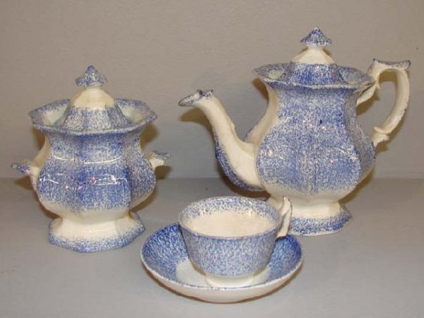 437: MINIATURE SPATTERWARE TEA SET. Three-piece set in