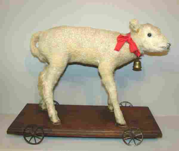 VICTORIAN PULL TOY. Stuffed lamb on a wooden base