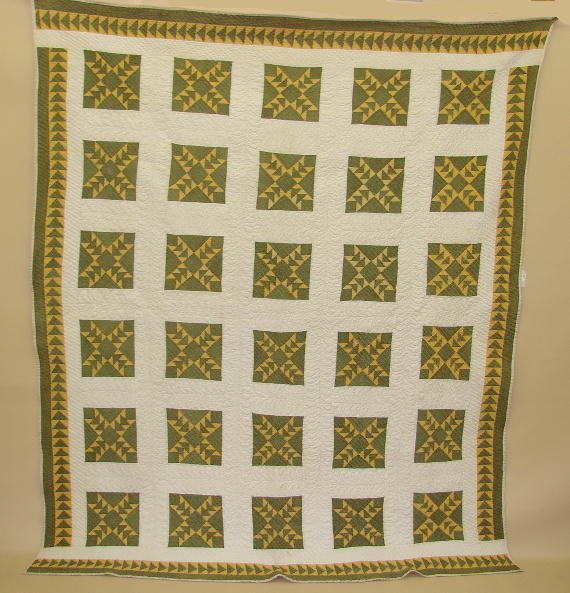 570: PIECED QUILT. Odd Fellows pattern in mid 19th