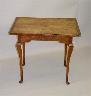 QUEEN ANNE TEA TABLE. Maple and birch with an old re