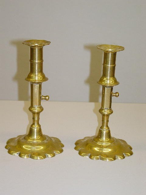 3: PAIR OF EARLY BRASS CANDLESTICKS. Domed bases with s