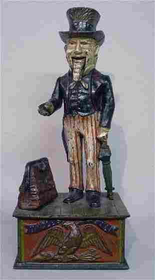 "CAST IRON MECHANICAL BANK. ""Uncle Sam"", Norman #5740"