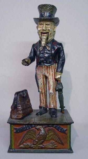 "5: CAST IRON MECHANICAL BANK. ""Uncle Sam"", Norman #5740"