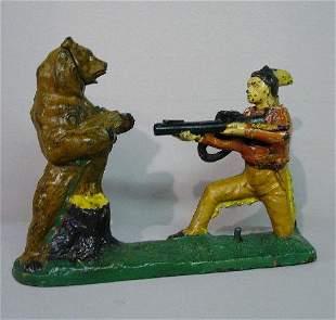 CAST IRON MECHANICAL BANK. Indian & Bear, N#2980-a.