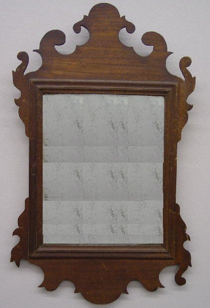 14: CHIPPENDALE SCROLL MIRROR. Mahogany with an old dar