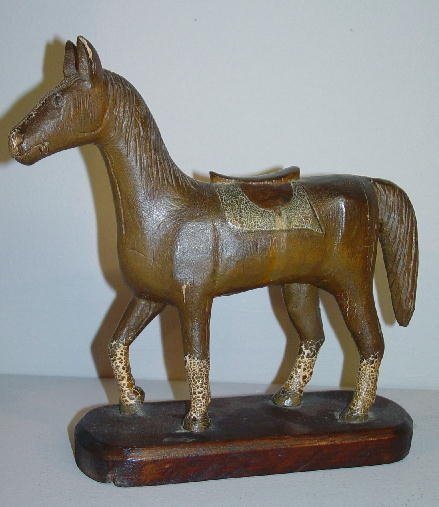 20: STYLISH FOLK ART HORSE. Carved wooden horse with a